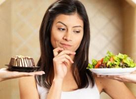 woman-choosing-between-salad-and-cake